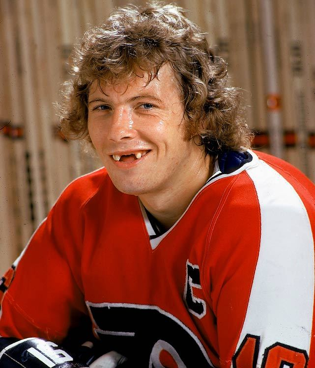 Bobby Clarke shows off his toothless grin during a photo session with SI's John Hanlon. Clarke, who was drafted 17th overall by Philadelphia in 1969, was named captain of the Flyers at age 23. His rough and, at times, controversial style of play gave him the title of one of hockey's most hated villains on the sport's most hated team, but he was beloved in Philly where he led the Broad Street Bullies to two Stanley Cups. Upon retirement, he had amassed 358 career goals and 1,453 penalty minutes. He was inducted into the Hockey Hall of Fame in 1987 and served as the Flyers' GM from 1994 to 2006. (John Hanlon/SI) GALLERY: Iconic Photos of the Philadelphia Flyers