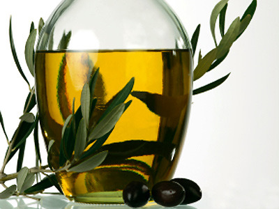 Just two tablespoons of olive oil a day could cut heart disease risk!  Two tablespoons of olive oil a day almost halves the risk of heart disease while one spoonful cuts the risk by 28 per cent The results are based on the diets of nearly 41,000 adults in the European Prospective Investigation into Cancer and Nutrition, which began 20 years ago. While the research, published in the American Journal of Clinical Nutrition, found olive oil does not appear to reduce cancer deaths, there was an enormous impact on the death toll from heart disease.