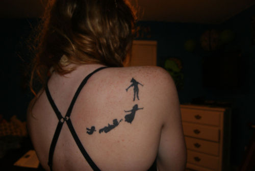 fuckyeahtattoos:  Peter Pan. My mom told me I bare his sense of adventure and never wanting to grow up. As a child, this was my favorite movie. Heck, when we go to WDW I still freak out at the site of him. Tattoo was done at KaoZ in Pensacola, Florida. I don't really remember what the tattoo artist's name was. But anyway, Stay adventuring and not a grown up!