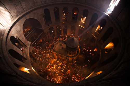 in-timore-dei:  Holy Fire ceremony at the church of the Holy Sepulchre in Jerusalem