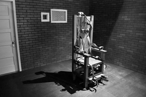 """ramirezdahmerbundy:  Robert Blake was a condemned prisoner in Texas who was executed in 1929 for murder. Before going to the electric chair, Blake kept a curious chronicle of activities and dialog between other condemned prisoners on Death Row. His remarks, which detail the anxiety of nine condemned men waiting to be put to death, appeared in the July 1929 edition of The American Mercury and were later used in the grim prison drama, The Last Mile. The prisoners mostly concern themselves in the possibility of a reprieve. When a telegram does arrive for one of the prisoners, he is incensed that it is not from the governor ordering a stay of execution, but from a sheriff asking if he can bring some additional visitors to see the man electrocuted. The prisoners share their last cigars and fruit and endlessly discuss their impending deaths, one stating in forced doggerel:  """"Why do they pull a black cap over your face and let it remain until you're dead? Because the high voltage of electricity will make your eyes pop out of your head!""""  The Death Row areas described by Blake in his grim narrative was immediately adjacent to the room housing the electric chair. At the end of his chronicle, Blake states: """"These lines are written while Six (referring to the condemned prisoner taking from cell number six) is being strapped into the electric chair. The door between the death chamber and Death Row is open."""" He quotes the words of the condemned man which he and the others can hear as Six awaits the current of electricity that will end his life: """"I hope that I am the last one who ever sits in this chair. Tell my mother that my last words were of her."""" Then Blake adds: """"The light goes dim as we hear the whine of the motor when the switch is turned on… The lights go dim twice more."""" One of the prisoners shouts from Death Row: """"They're giving him the juice again. Wonder what they're trying to do, cook him?"""" One of the condemned men says, """"I won't be able to sleep for a week."""" Anothe"""