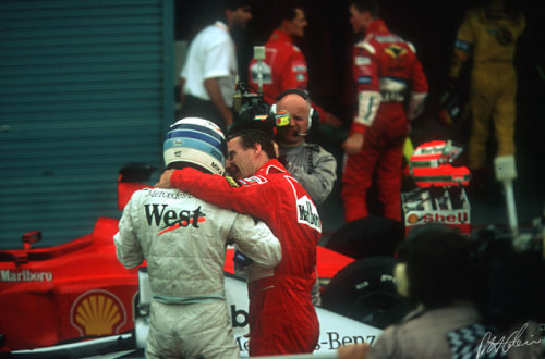Eddie Irvine making sure he is the first to congratulate Mika Hakkinen after his champion's drive at Suzuka in 1999 to clinch his second championship. In the background you can see Michael talking to his brother Ralf. Michael would go on to win the next five driver's titles, but the hardest fought would be his first against the still mightily strong Hakkinen-McLaren combination in 2000. Eddie Irvine would join the renamed Stewart side as Jaguar in 2000, driving for a couple of years and bagging a few podiums before eventually retiring from the sport. Ralf would continue with Williams until 2005, winning a handful of races before getting a lucrative deal with Toyota before retiring a few years later.