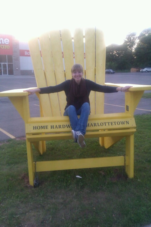 """Stop! Olivia needs her picture taken on the big yellow chair!"""