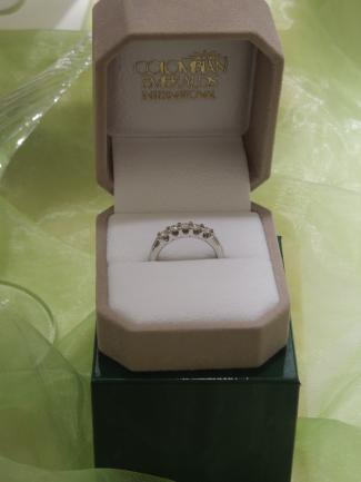 A while gold band with a row of 5 diamonds makes going green glamorous. A  wedding ring from Colombian Emeralds International- A sustainable jewelry company. http://www.colombianemeralds.com/