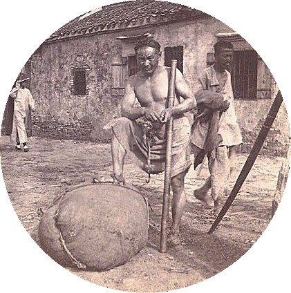 A coolie laborer in  Zhenjiang, China, ca. 1900.