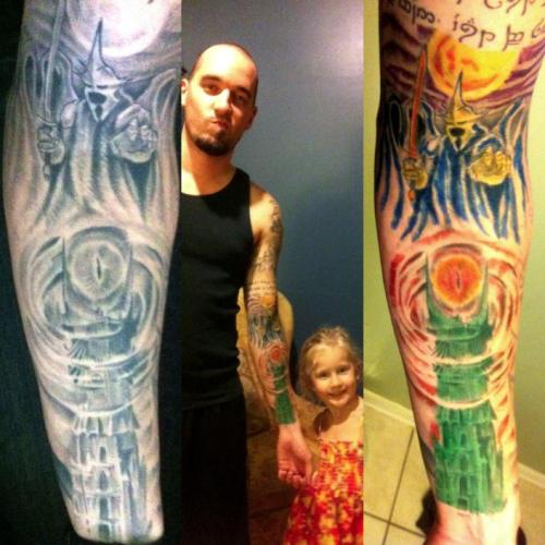 Adorable daughter colors in dad's tattoos!
