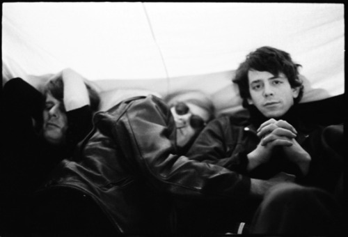 Andy Warhol & Lou Reed on a tour bus to Ann Arbor for their appearance at the March 12, 1966 University of Michigan Film Festival. Photo by Nat Finkelstein.