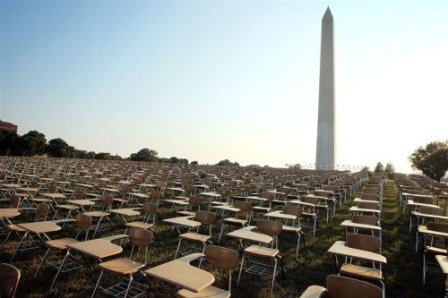 thepeoplesrecord:  An installation of 857 empty school desks, representing the number of students nationwide who are dropping out every hour of every school day, is on display at the National Mall on Wednesday, June 20, 2012 in Washington, DC. The installation was presented by not-for-profit organization College Board to call upon presidential candidates who are running for the White House to make education a more prominent issue in the 2012 campaigns and put the nation's schools back on track.
