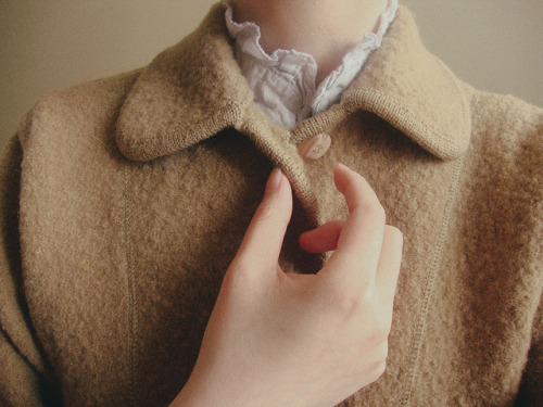 buttoning up by juni xu on Flickr.