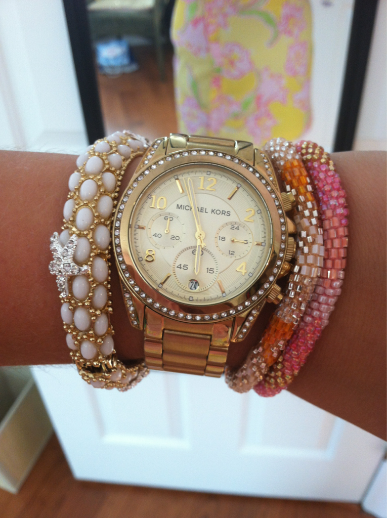 summer-kindofwonderful:  Stack of the day!  I have those 2 bracelets closer to her hand but in different colors! :)