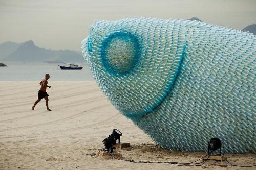 A fish sculpture constructed from discarded plastic bottles rises out of the sand at Botafogo beach in Rio de Janeiro. The city is host to the UN Conference on Sustainable Development, or Rio+20, which runs through June 22. via the cool hunter (the site, not me)