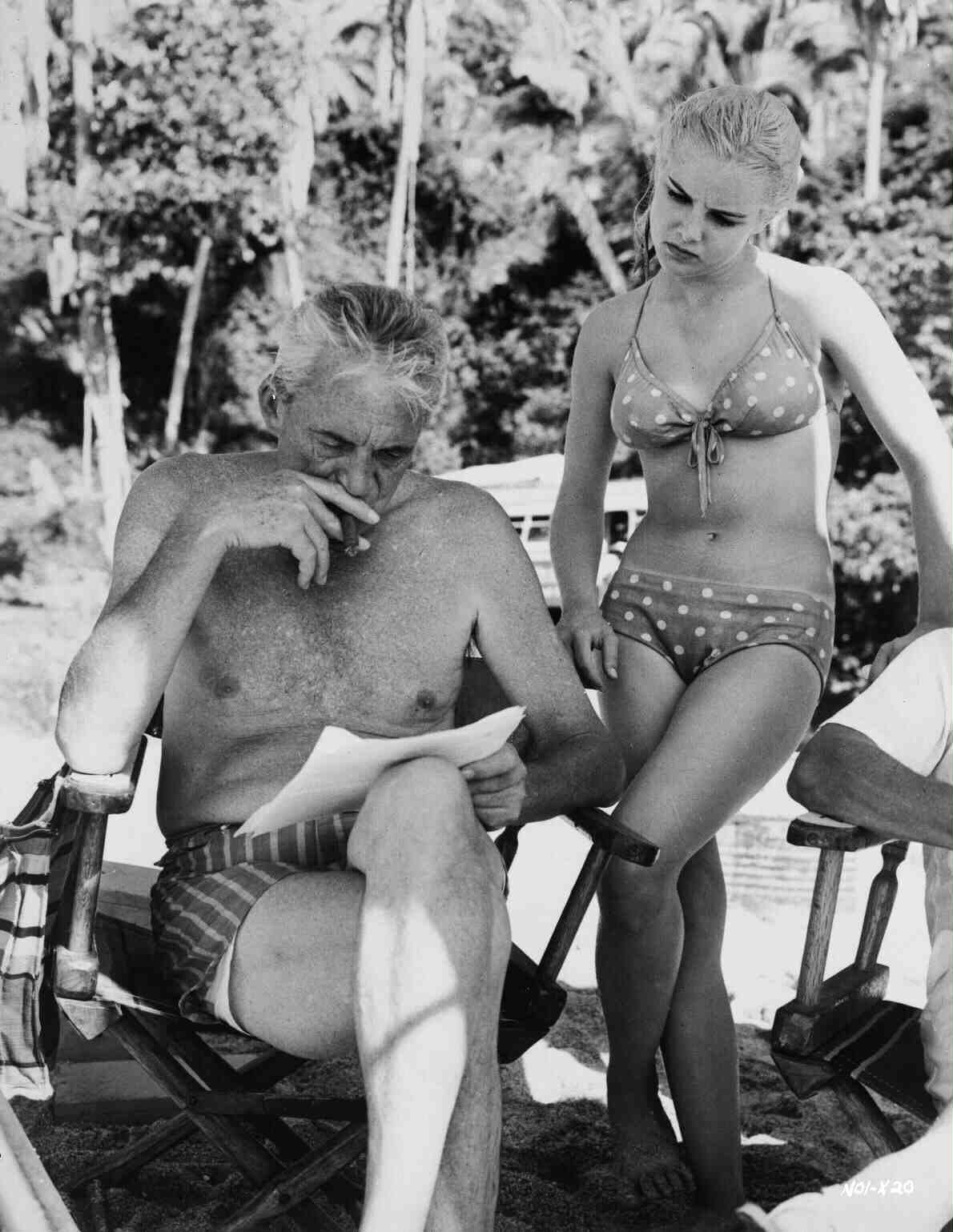 Director John Huston with Sue Lyon during the filming of The Night of The Iguana, 1964.