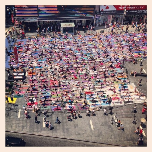 Of course anyone can find peace at the top of a mountain. But can you find it in Times Square? It is unquestionably the ultimate test of serenity to find inner peace in one of the busiest, if not the busiest, environment in the world. Yesterday evening, I found my zen among 10,000 other New Yorkers in the heart of New York's holy epicenter of hustle and flow during the 10th annual Athleta Mind Over Madness to celebrate the summer solstice. Mother Nature provided the natural heat Bikram studio. I challenged myself to quiet my mind in Times Square (of all places!) and was able to focus on grace, quality of the poses, while zoning out all the tourists snapping pictures at us and pointing with strange looks on their face. The afternoon bikram session broke a world record today by being the largest Bikram yoga class in the world! (Bikram is a yoga practice that requires you to remain in a room heated to 105 degrees for 90 minutes. Today was the hottest day of the year so far, so it was fitting to celebrate the solstice with Bikram in the heart of the best city in the world!) It was an extraordinary paradox – amidst animated billboards, lights, and honking cabs, thousands of yogis in deep backbends and twists created an aura of stillness. Typically I cannot stand Times Square,as the slow walking people crowding the streets test my patience a bit too much - especially during lunch break when I'm on a mission - so this yoga practice tested my grace and ability to just relax and let the chaos outside me melt away. If we can do this in Times Square, we can do this at work or in any stressful situations that faces us, instead of reacting with agitation and impatience, if we react with a deep sense of poise and calmness,whatever demonsmay befacing us don't seemas wicked, and may not be demons after all. The awfulness (orlevel ofease!)of a situation is all us - we are observers. How we react makes all the difference. A challenging yoga pose really doesn't have to be so difficult
