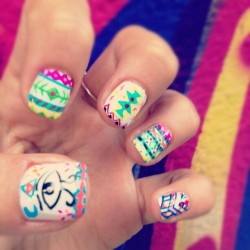 rianailz:  My last customer drew these designs and I made them happen on her nails.. (Taken with Instagram at Maritza's Unisex Salon)