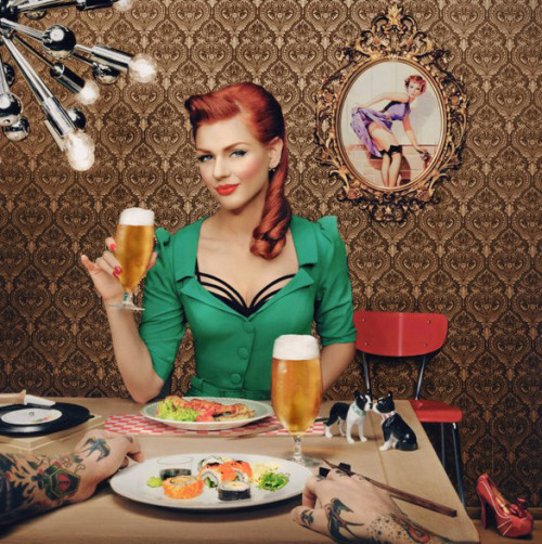 "gretamacabre:  ""all about me :)"" dogs, damask walls, sushi, vinyl, red hair, emerald dress, tattoes, heels… :) Cheers from Oslo!Photo: Fred Jonny™Photoass.: Alberto PalladinoStyling: Linda Wickmann / PudderHair & make-up: Sissel Fylling / PudderInterior: Jannicke and Alessandro / PudderAgency: Neolab / Kenneth Rasmus GreveClient: Clausthalere / HansaModels: Ivana Benko (Greta MaCabre) and Tarjei Strøm — at Oslo, White Light Studios"