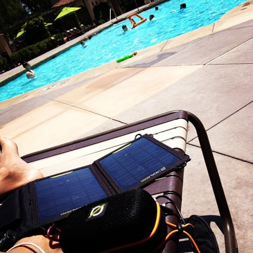 Soaking up the solar power by the pool (Taken with Instagram)