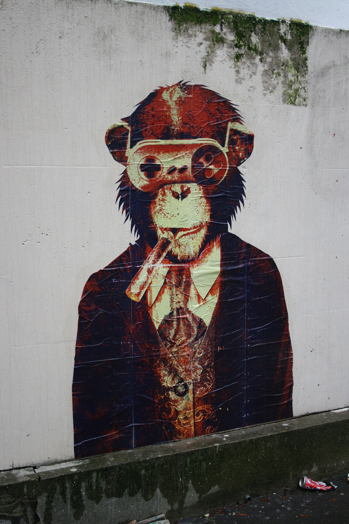 STREET ART WITHOUT BORDERS  archiemcphee:  We love this dapper, cigar-smoking, besuited chimpanzee wearing Nintendo controller glasses. Look at how awesome he is! This wheatpaste piece was created by artist Vinicius Quesada and put up on the streets of Paris, France as part of the Street Art Without Borders project. Photo by streetsnapshot.