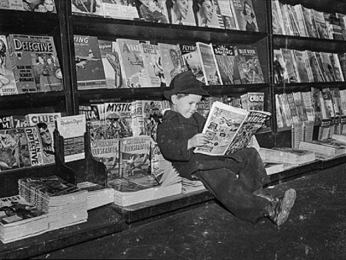 Here's a vintage photo of a 1942 newsstand—the young reader having made the wise choice of an issue of CAPTAIN AMERICA COMICS.