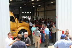 "If you managed to make it out to the Truckworx Kenworth facility last Tuesday, you saw what a great show it was. We had a full house and the theme was all T680. We drove our 76"" sleeper truck right into the bay, and surrounded it with lunch tables. Like the Buffalo event, there were prizes and gift bags for everyone in attendance. Where else can you go to see a great new product, and have a chance to win a 42"" flat screen television?   Are you feeling lucky? Although the event was on Tuesday, there was so much business going on throughout the dealership, I had people coming up to the trucks the minute we arrived through the minute we left for Dallas. On the day of the event, we actually had to add more tables for the lunch crowd. We must have had at least 250 people at this event, and at one point I think the tour trailer reached its maximum occupancy limit. I definitely reached my aerobic threshold walking customers through the trailer, swiveling the passenger seat on the sleeper display and explaining the functionality of the air assisted hydraulic clutch.  ""We specifically designed this clutch to require just 33 pounds of pressure to operate. Our goal; to make sure that anyone feels comfortable for the long haul. Everything from the pedal pressure to the amount of travel is specifically tailored to our specifications.""  ""The entire cab is assembled using robots. Almost the entire cab is held in place by fixtures before a single henrob fastener is installed. By doing so, we ensure that the cab is assembled according to the geometry of the panels, and not the location or precision of the fastener holes. The resulting cab is extremely repeatable for optimale panel and door fit, every time.""  At Kenworth, heritage means everything. While exploring the dealership grounds, I noticed more W900's on site these past two days than I've seen in a long time. The same quality, style and dependability that built the Kenworth name goes into every product they make, and that's especially evident when lovers of the W900 get excited about the T680. There's something to be said for having the same customer who loves the look and feel of a classic W900, look at the T680 with envy.  When two completely different styles appeal to the same customer, you know you've accomplished something. Whereas the W900 exudes power in brute force, the T680's low, menacing shape appears able to cut through the harshest headwinds with ease. Both appeal to drivers concerned about looks, and the T680 sits low in the front, with bulging haunches. If the W900 is a freight train, the T680 is a Boeing 787. Whether it's a plane, train or automobile, the Birmingham crew did a great job enlightening our customers to the newest edition to the Kenworth family.  Like clothing, one size does NOT fit all. A truck for every customer, and every application. If you weren't crawling through the trucks, you were enjoying lunch with the Worktrux group. They brought in Dreamland Barbeque for some pulled pork sandwiches and ribs. The Dreamland crew hauled in their enormous barbeque trailer to cook some serious ribs. Add in some sweet tea, and you aren't going anywhere until you work it off with a walk through the show.  Unfortunately, this is the only thing we couldn't find room for in the T680. Thank you Kenworth of Alabama, for a great time and a spectacular show for our trucks. This has been my first trip to the south, and they definitely proved they know how to do business down here. I can see why they continue to thrive, even when the economy struggles to gain traction. It's times like this that every load counts, and this is the place go when it comes to getting, and keeping trucks on the road.  So long Alabama, it's time for Texas. Peter"