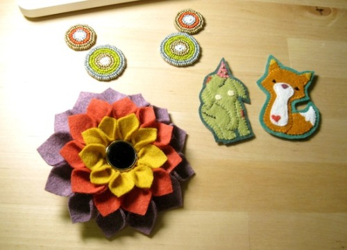 This is all my craftiness from the past 2 days. Those circley medallions are going to be part of a large bib-like necklace - super excited about that. The two felt patches are for a swap I'm doing (one of them's a zombie party elephant - say that three times fast!) and the flower brooch is a result of not martha. I feel pretty fulfilled craft-wise right now, and I'm falling in love with wool felt!