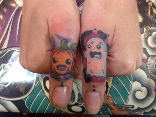 "fuckyeahgirlswithtattoos:  my new thumb tattoos! I reeeeally love Halloween :3 ^""^ by Curtiss Besigner of Energy Tattoo in Santa Barbara, California."