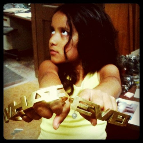 "My daughter, Sakura, with ""WHAT EVER"" brass knuckles made by her daddy's shop, Barnacle Bros."