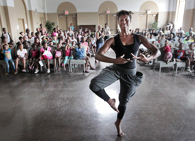 guardian:  Memphis, US: dance student Takeisha Washington, from the Alvin Ailey dance school in New York, demonstrates a pirouette for day camp kids at the Emanuel Episcopal Center. Washington, who is originally from Memphis, is visiting her former dance teacher Karen Zissoff with Dancers Inc and volunteered to talk to the kids Photograph: Jim Weber/AP