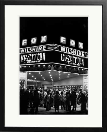 "The marquee of the Fox Wilshire theater as it appeared on the evening of the premier of Led Zeppelin's concert movie ""Song Remains The Same"" on Octotber 21, 1976 in Los Angeles, California."