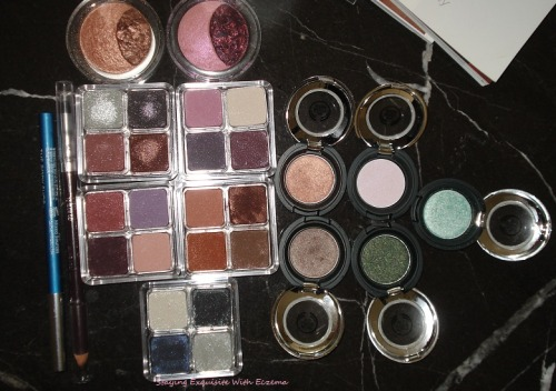 My collection of eyeshadows from The Body Shop.  These are my favorite eyeshadows.  They are smooth, pigmented and long lasting.  The Carbon Brown Eye Definer and Metallic Eyeliner in Brilliant Blue are also amazing.  I have not used another liner since I bought these two.  And I don't like using another brand of eyeshadow.  If you have never tried any of the cosmetics from The Body Shop, you should =)