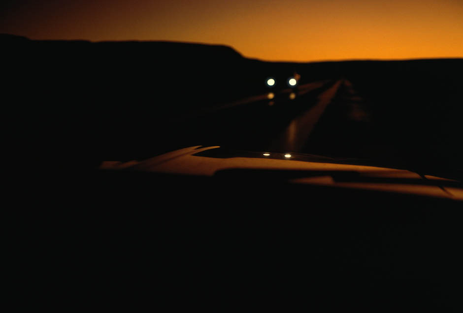 mpdrolet:  A car drives down a desert road in twilight, USA, September 1967 Ernst Haas