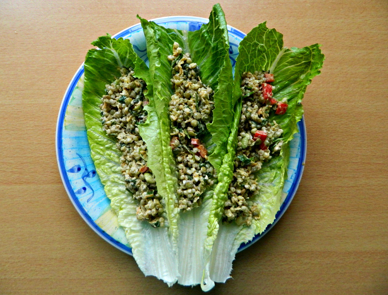 "Romaine wraps filled with ""protein power goddess bowl"" salad. (aka lentils, buckwheat, veggies and parsley in a lemon/garlic/tahini dressing.) Recipe can be found here."