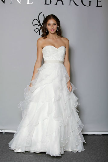 Sweet twist front bodice gown with ruffled tiered A-line skirt. Anne Barge F2012, style Lyric. Read full post here.