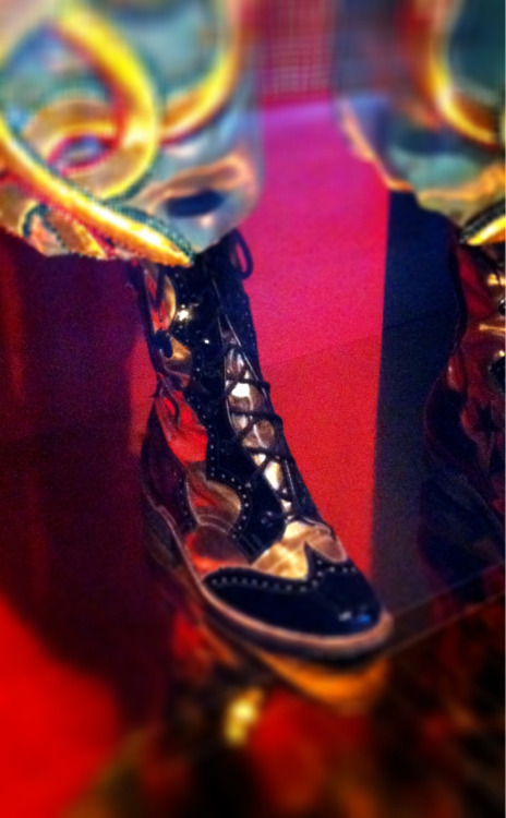 Gold and black patent, wing tip combat boots, Bolivian. At Le Musee de quai Branly
