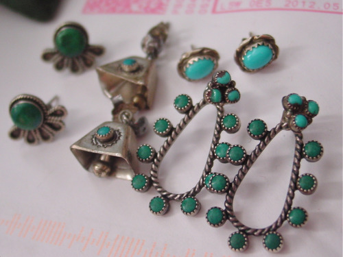 Collection of vintage southwestern turquoise earrings.
