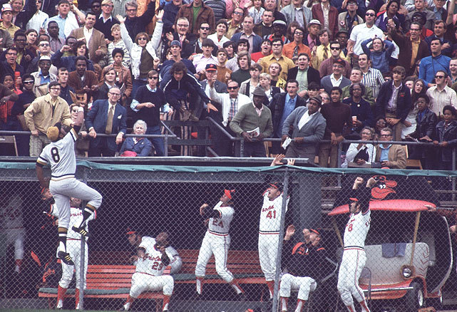 Willie Stargell climbs the outfield fence but is unable to make the catch during gmae 1 of the 1971 World Series between the Pirates and Orioles. Pittsburgh would lose the game (5-3) but win the series in seven games with Roberto Clemente taking MVP honors. (Walter Iooss Jr./SI) GALLERY: Classic Photos of the Pittsburgh Pirates | Baltimore Orioles