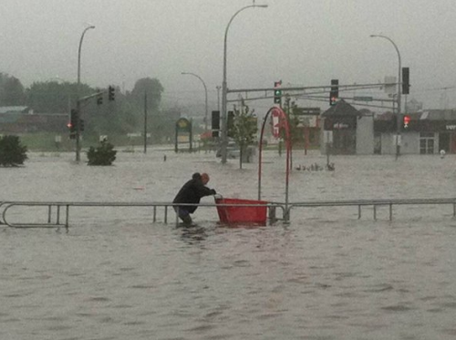 Man Returns Shopping Cart in Flood There! Now the parking lot looks neat and tidy.