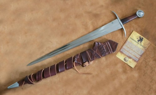 "ghost-of-gold:  1354 14th C Medieval Sword This classic knightly sword has been reinterpreted many times in the modern world. This design is based on a 14th century knightly sword with some unique features. In addition to the classic fullered blade and relatively plain curved guard, this sword has an interesting inscription on the pommel.The Latin text reads, ""Mai vos ostendo bonitatis, sinceritatis et clementia ad vestri inimicatus et omne vivum entis."" Translated, it says, ""May you show honor, integrity and compassion to your enemies and all living things."" A truly chivalrous ideal for a knight to live up to, and a stirring reminder for us in modern times. Specifications1060 High Carbon SteelGuard and pommel: mild steelTotal length: 34.5 ""Blade length: 27.5""Blade width at base: 2.8""Weight: 2 lbs. 12 oz."