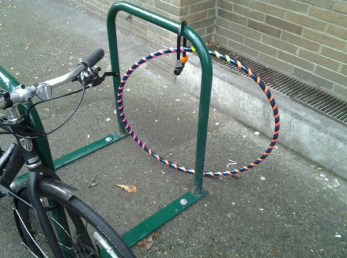 Hula Hoop Locked Up on Bike Rack I've got to lock it up. Last week my hula hoop was stolen and I had to walk home like a normal person.