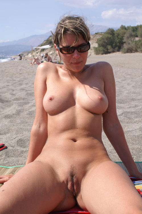Nice milf next door naked in the beach