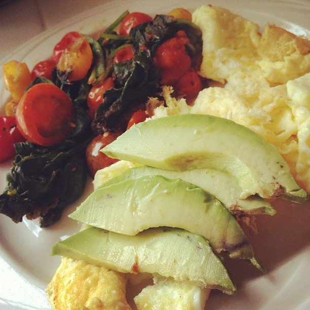 Eggs, avocado, and sautéed spinach and tomatoes in coconut oil! Breakfast time! what'd u eat? #eatclean  (Taken with Instagram)