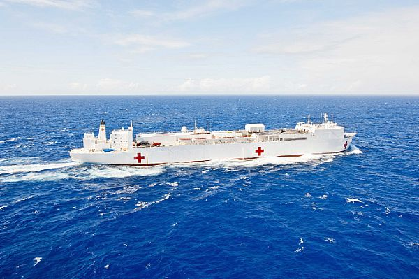The Military Sealift Command hospital ship USNS Mercy (T-AH-19), lead vessel for Pacific Partnership 2012, transits the Pacific Ocean toward Guam.