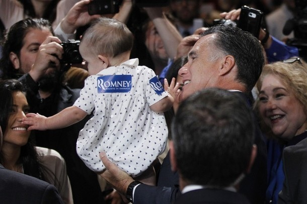 Bag's Take-Away:  Meanwhile, at NALEO, a baby thrust into Mitt Romney's hands opts for self-deportation to mommy. via DayLife (credit:Charles Dharapak/Associated Press caption:  Republican presidential candidate, former Massachusetts Gov. Mitt Romney, holds a baby as he greets attendees at the NALEO (National Association of Latino Elected and Appointed Officials) conference in Orlando, Fla. , Thursday, June 21, 2012.) Visit BagNewsNotes: Today's Media Images Analyzed ————— Topping LIFE.com's 2011 Best Photo Blogs — also follow us on Twitter and Facebook.