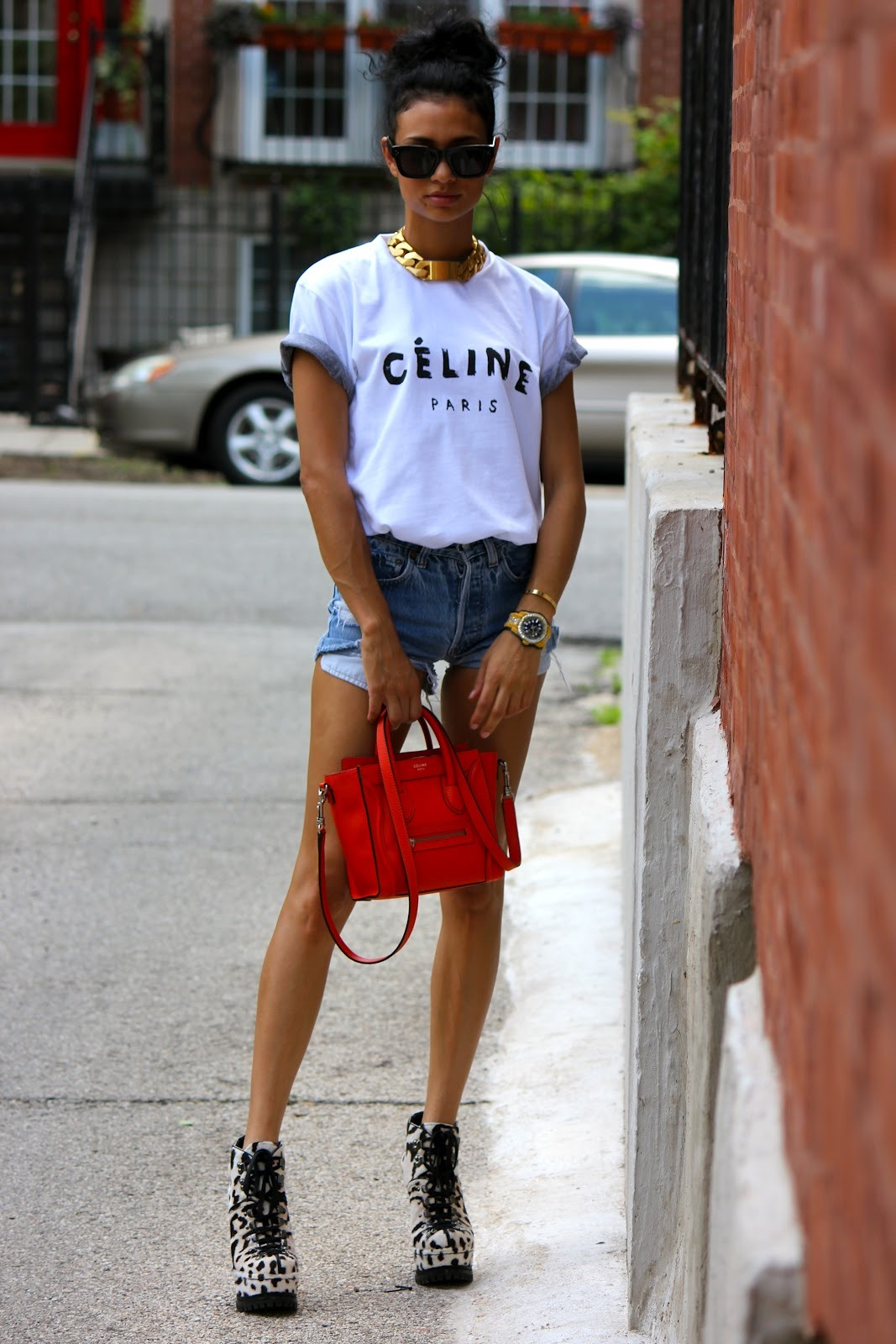 Celine t-shirt with a grey American Apparel 50/50 t-shirt under it. vintage Levi cutoff shorts and Alaia hiking boots.Celine ID necklace (image: mademoisellekdia)