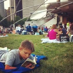 The next generation of never-without-a book. @gpmf. I am so proud. (Taken with Instagram at Grant Park Music Festival in Millennium Park)