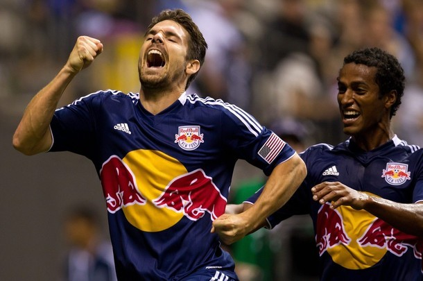 New York Red Bulls' Jonathan Borrajo Heath Pearce, left, and Roy Miller, of Costa Rica, celebrate Borrajo's goal against the Vancouver Whitecaps during the second half of an MLS game.
