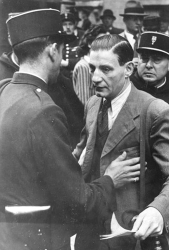 failfail9:  Two French policemen harass a Jewish man; 1941.