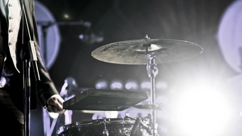 Marcus Mumford of Mumford & Sons finds a way to play drums even with a broken hand at Southside Festival in Neuhausen Ob Eck, Germany on 22 June 2012. Photo © Raphael Timm.