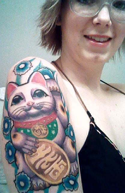 my maneki neko or also known as the japanese lucky cat done at truel love tattoo by gavier in kemah, texas