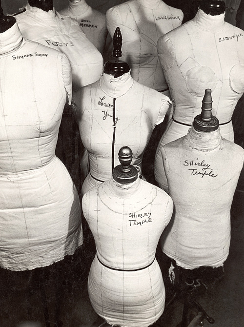 deforest:  A dressmaker's forms in Wardrobe Department at 20th Century Fox: Simone Simon, Ethel Merman, Loretta Young, Louise Hovick (Gypsy Rose Lee), Barbara Stanwyck, a common one for the Peters Sisters (who are  the same size), and two for the ever-growing Shirley Temple. Photographed by Margaret Bourke-White, 1937.