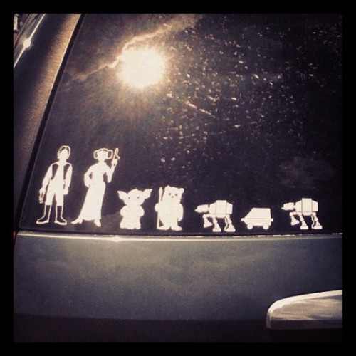 Someone had these Star Wars stickers to represent their family at the mall today. Wish I could have asked them if it was Han or Greedo who shot first! (Taken with Instagram)